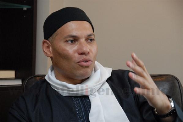 """Karim WADE : """" Je n'ai souscrit ou accepté aucun arrangement, aucun deal avec Macky SALL (...) Je suis en route pour ..."""""""