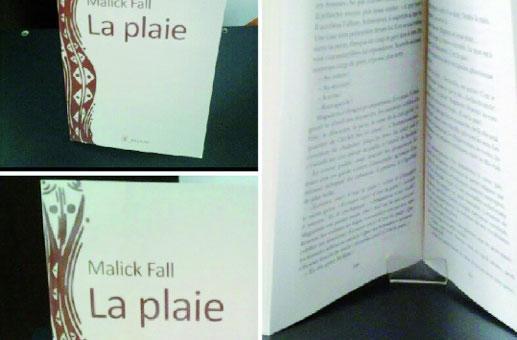 """CULTURE: La réédition du roman """"La plaie"""" de Malick FALL, présentée à la Librairie Athéna."""