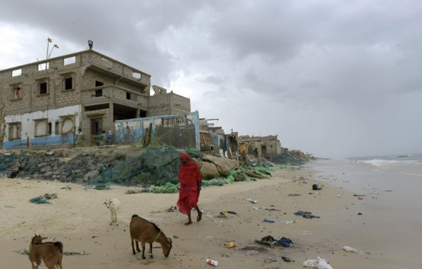 A picture taken on on October 26, 2015, in Saint-Louis du Sénégal shows the remains of houses in the Gokhou Mbathe district that were abandoned because of the approaching sea. Photo: AFP PHOTO / SEYLLOU